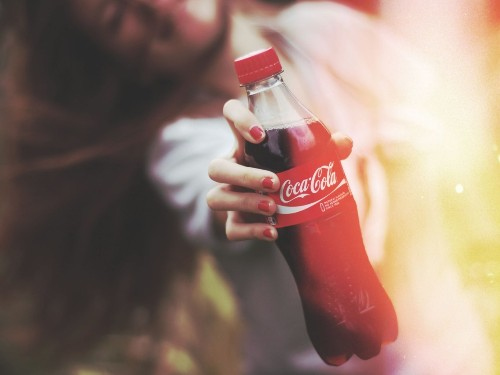 Coke makes more by selling less soda