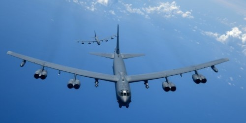 US B-52 bombers tore through the South China Sea in a power play ahead of a sit-down between the US and Chinese defense chiefs