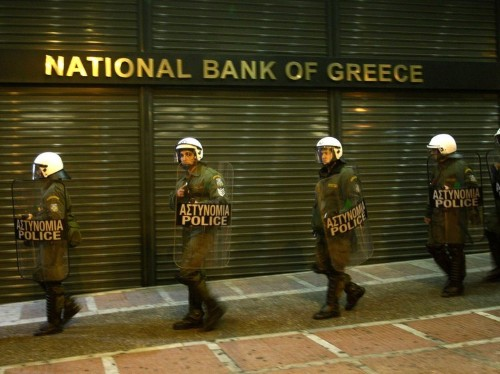 Markets prepare for the 'almost certain' Greek default Tuesday