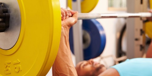 An exercise scientist demonstrates the proper bench press