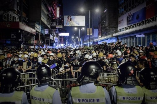 Hong Kong police charge leaves protesters injured