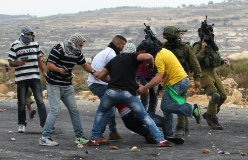 Disguised as stone-throwers, infiltrators open fire on Palestinians