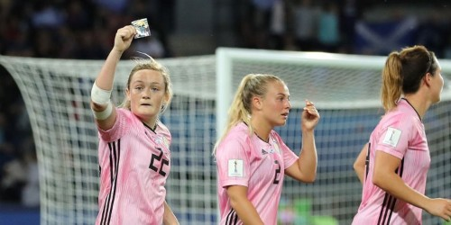 Erin Cuthbert celebrates goal by kissing childhood picture from father