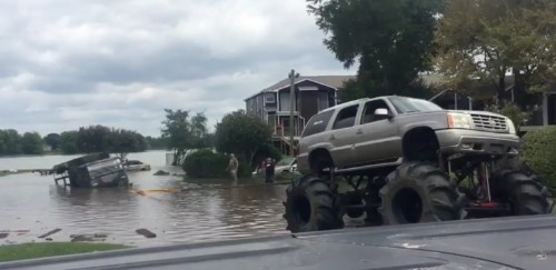Watch a monstrous Cadillac Escalade tow a submerged military vehicle from Harvey floodwaters