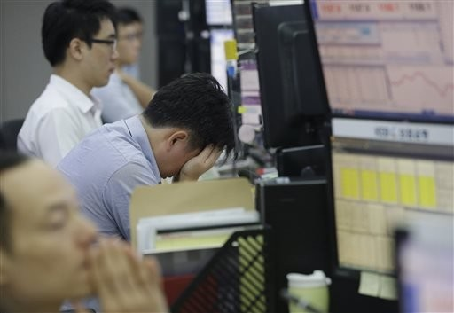 Asian stocks post modest gains after China rate cut