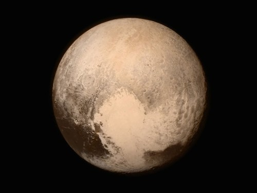 The first video of flying over Pluto was just released, and it's absolutely amazing