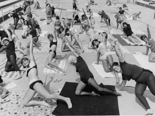 35 vintage photos of bizarre exercise fads from the last 100 years that required little effort and probably yielded few results