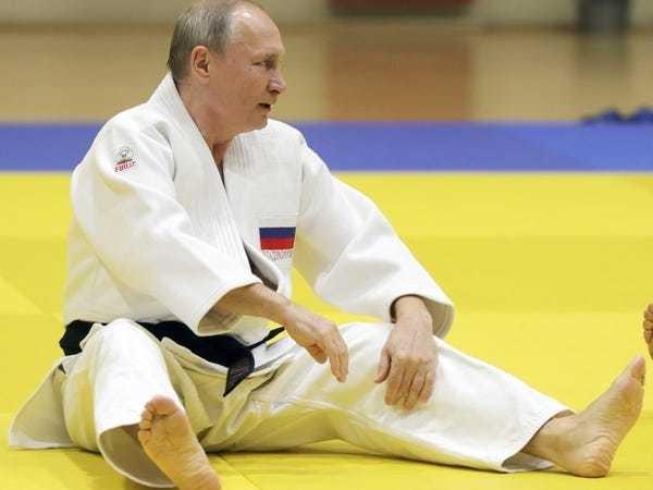 Vladimir Putin pulled to floor by female judo star Natalia Kuzyutina - Business Insider