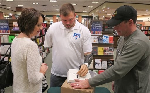 Soldier who lost 4 limbs aims to inspire others with book