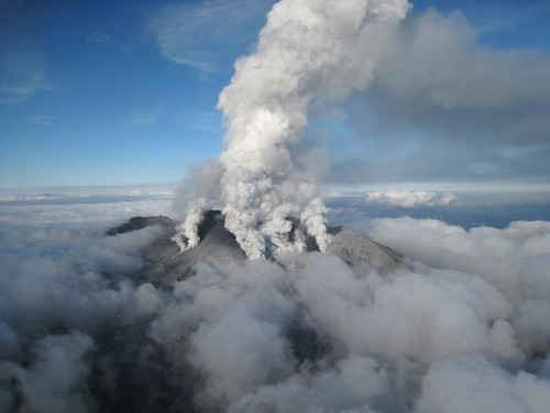 Rescuers rush to reach dozens trapped on erupting Japan volcano