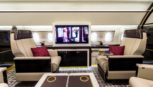 This massive private jet has an interior designed to look like a vintage train