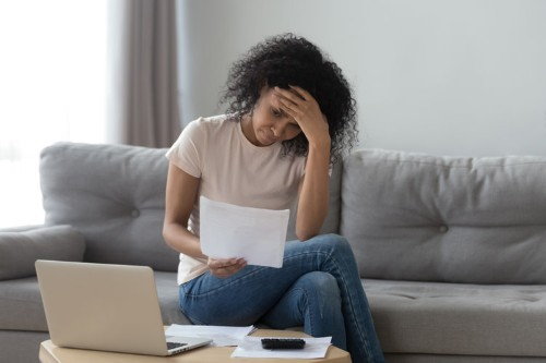 I paid off $22,000 in credit card bills thanks to a debt settlement company, but I wouldn't do it again