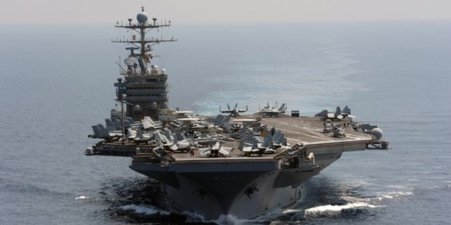 A heavily-armed US carrier strike group has moved into position near Iran as tensions mount