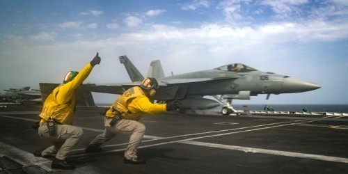 A US carrier strike group has been flexing its muscles in a show of force to Iran