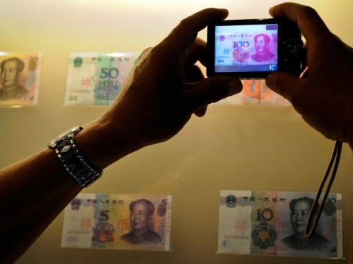 Here's why China is weakening its currency