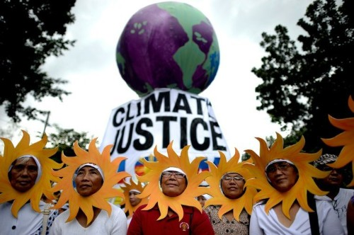 Thousands march on climate change in Manila, Brisbane