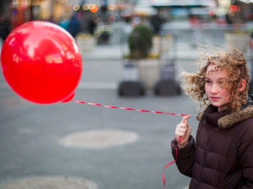 Why the phrase 'the red big balloon' sounds wrong to most people