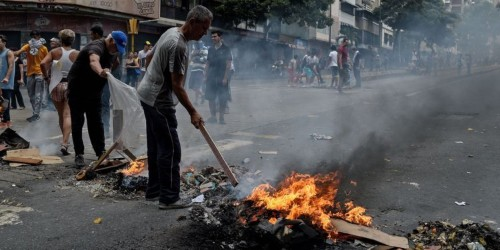 Venezuelans set up burning barricades to protest 3rd major blackout in a month as Nicolás Maduro announces a plan to ration electricity