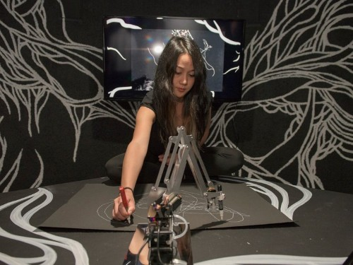 This robotic arm draws almost as well as a human artist — because it sort of is one