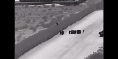 Border Patrol video shows more than 110 migrants scaling the 18-foot US-Mexico border fence with a ladder