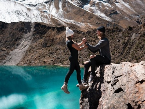 Instagram travel couple defend 'stupid' photo hanging off cliff