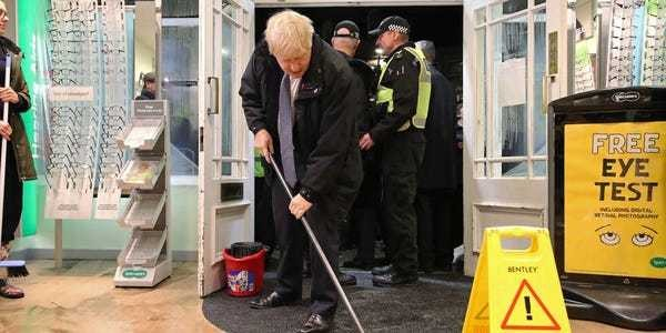 Boris Johnson tried to mop up some floodwater and it didn't go particularly well - Business Insider