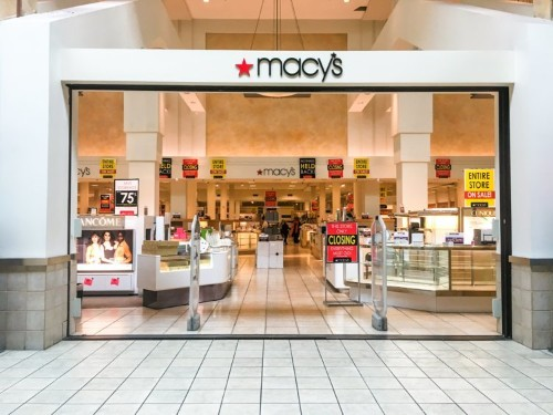 Macy's blamed a 'mounting problem' of unsold inventory and heavy discounting for weaker-than-expected earnings