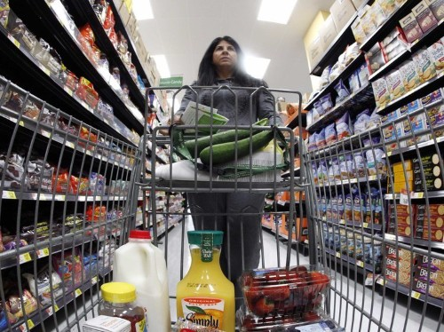 Whole Foods and Walmart are battling for one crucial set of customers — and it reveals a dark truth about the American middle class
