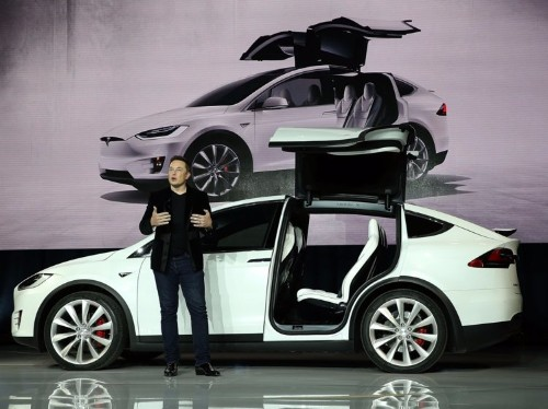 Tesla says those exotic falcon-wing doors on the Model X SUV were almost a disaster
