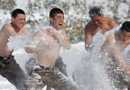Chinese soldiers trained with swords in the snow near the country's border with Russia