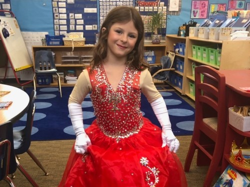 An 8-year-old wore a bejeweled ball gown for school pictures