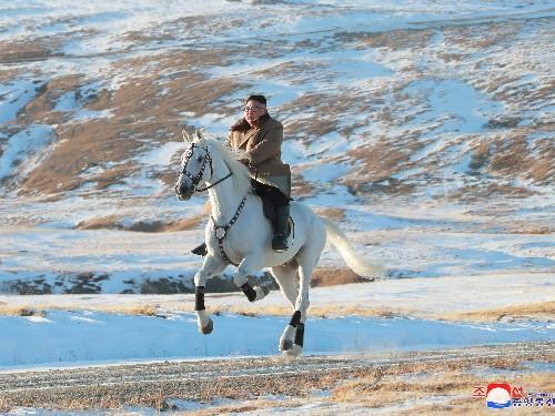 Kim Jong-Un is riding a white horse through the snow in new propaganda - Business Insider