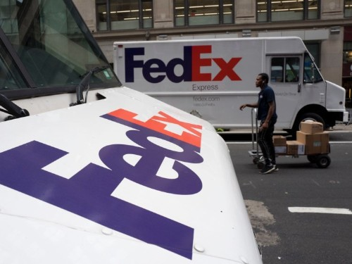 The internet is obsessed with a FedEx employee who cruised through Manhattan on a delivery cart — but FedEx says the speed-meister broke company standards