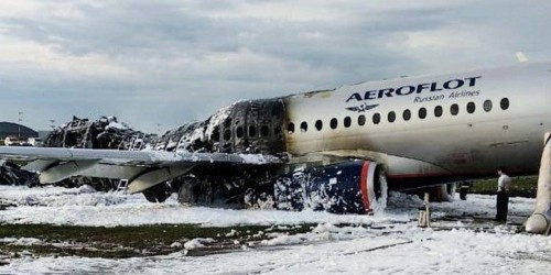 A Russian flight attendant died as he tried to open an emergency exit and help passengers escape from the Aeroflot plane fire that killed 41 people in Moscow, state media reported