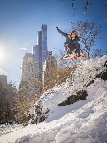 The NYC blizzard is getting so crazy, people are skiing and snowboarding in the streets
