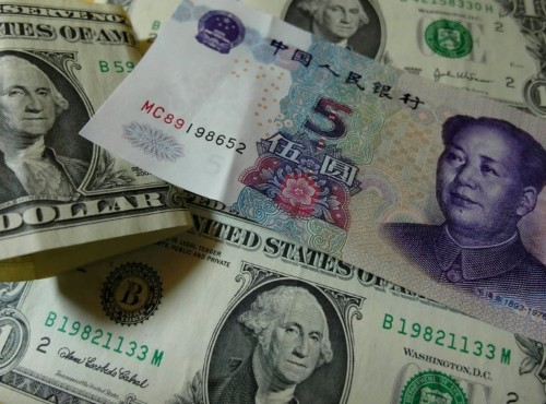 Emerging economies let currencies slide to stay competitive