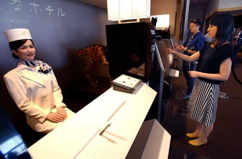 A Japanese hotel run almost entirely by robots is expanding to 100 locations — here's what it's like to stay there