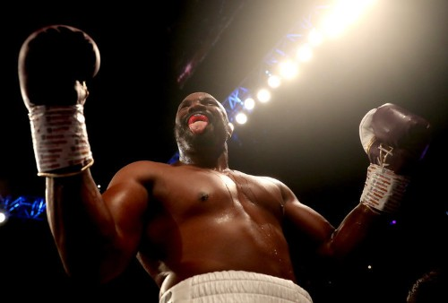 Dereck Chisora knocks Artur Szpilka out on his feet, before pummelling him to the floor in the second round