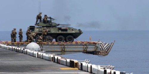 The Marine Corps is strapping armored vehicles to the top of Navy ships to fend off small boats and other threats