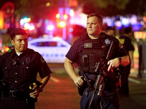 Police found bomb-making materials and a journal with combat tactics at the Dallas shooter's home
