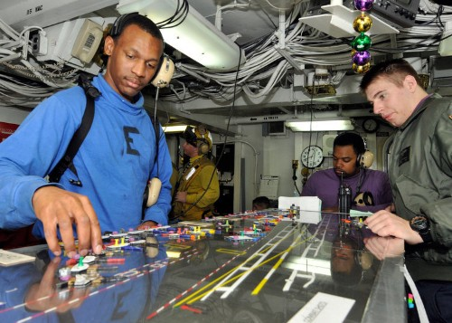 24 photos that show the synchronized chaos of America's aircraft-carrier flight decks