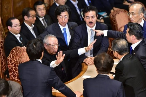 Japan lawmakers scuffle over controversial security bills