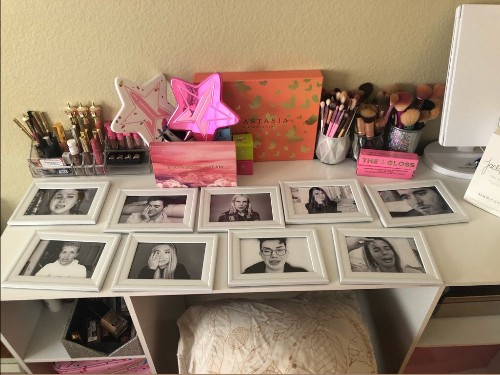 Woman decorates beauty desk with framed pictures of crying YouTubers - Business Insider