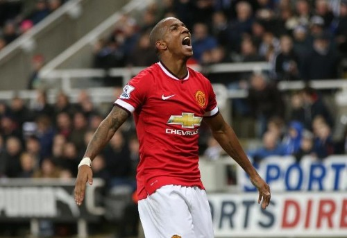 Young rescues United, Chelsea preserve lead