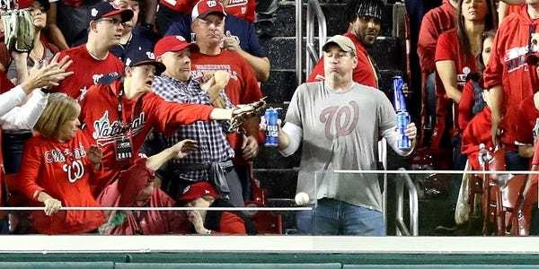 Heroic baseball fan takes home run to the gut in order to save beers - Business Insider