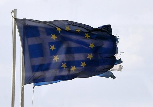 Greece hails 'turn in the tide' but debt problems loom
