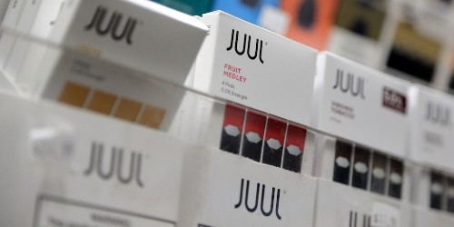 Juul halts US sales of its fruity-flavored vaping pods as regulators investigate it for marketing to minors — just hours after Philip Morris said its rival product targets adults
