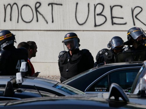 Uber is suspending one of its services in France after taxi drivers rioted in the streets