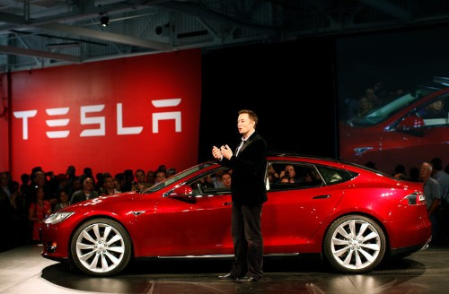 Teslas will soon drive themselves, but Elon Musk doesn't want drivers to check out
