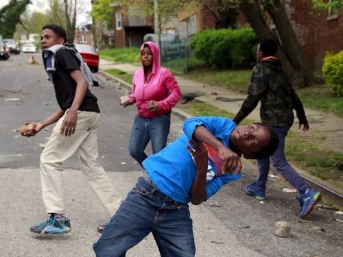 Photos of Baltimore devolving into chaos as riots grip the city